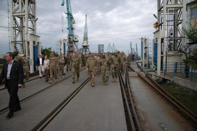 Logisticians and leaders walk down a railroad ramp used for loading cargo ships at the port of Batumi, Georgia, April 26 during the Southern Sustainment Terrain Walk, organized by the 21st Theater Sustainment Command. The tour was held to improve understanding of capabilities and resources in Southern Europe.