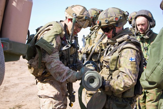 A Soldier assigned to Fox Troop, 2nd Squadron, 2nd Cavalry Regiment, U.S. Army, shows a soldier from the Finnish Army an AT-4 anti-armor weapon during Arrow '16 at Niinisalo Training Area, Finland, May 4, 2016. Arrow '16 is a bi-lateral exercise in which F Troop is achieving Dragoon certifications and simultaneously sharing valuable lessons learned while training. This is the first time the U.S. Army has participated in this annual event. (Photo by: Staff Sgt. Jennifer Bunn, 2nd Cavalry Regiment Public Affairs)