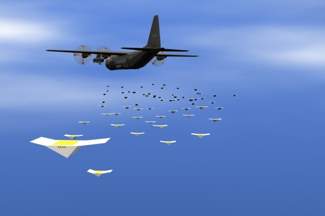 A C-130 airplane releases a swarm of Close-In Covert Autonomous Disposable Aircraft, or CICADA, gliders.