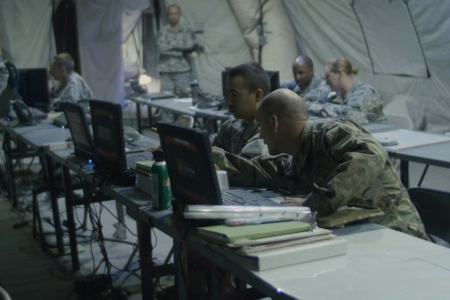 Soldiers inside the 2nd Brigade, 1st Armored Division Brigade Main Tactical Operations Center (TOC) participate in the Network Integration Evaluation (NIE) 16.2 at Fort Bliss, Texas. (PEO C3T photo)