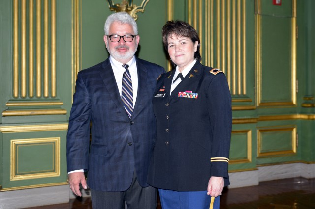 Col. Martha K. Lenhart, MD, PhD, on the right, and husband, Dr. James Cox, Jr., Col., USAF (Ret), on the left, attended the 2016 Heroes of Military Medicine Awards, May 5, 2016.  Lenhart was named the U.S. Army Hero of Military Medicine.