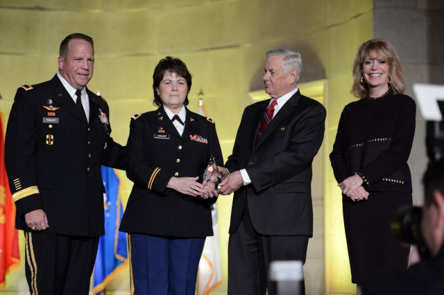 Col. Martha K. Lenhart, MD, PhD, second from the left, was named the U.S. Army Hero of Military Medicine during the 2016 Heroes of Military Medicine Awards, May 5, 2016, in Washington, D.C.  On stage with Lenhart are Brig. Gen. Robert D. Tenhet, the deputy surgeon general of the Army and the deputy commanding general (support) of U.S. Army Medical Command, left; John W. Lowe, president and CEO, the Henry M. Jackson Foundation for the Advancement of Military Medicine, Inc., second from right; and Cynthia L. Gilman, vice president, Henry M. Jackson Foundation for the Advancement of Military Medicine, Inc. Center for Public-Private Partnerships, on the right.