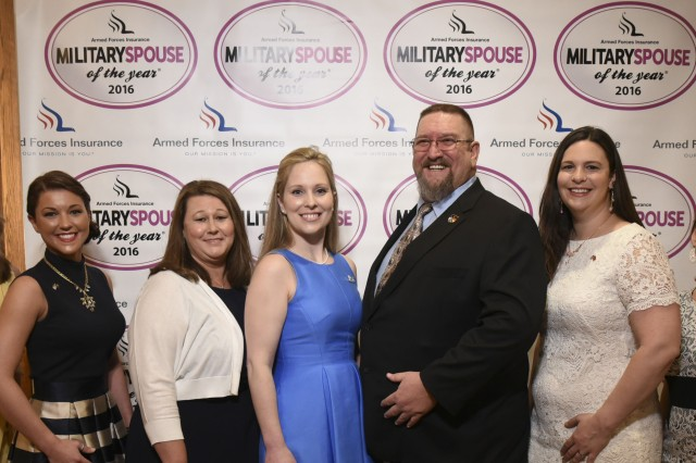 Army Spouse of the Year Dave Etter stands on stage May 5, 2016, next to spouses of the year from other services at Joint Base Myer-Henderson Hall, Va. Right of him is Military Spouse of the Year Natasha Harth, representing the Marine Corps. To her right is Michelle Aikman, Air Force spouse of the year. Far left is outgoing 2015 MSOY Corie Weathers from the Army. Right of her is Lindsay Bradford, this year's Air Force spouse of the year, then Cara Loken of the National Guard and in the blue is Jennifer Mullen, Coast Guard SOY. (Reprinted here and on any military publication with permission of AP Images)