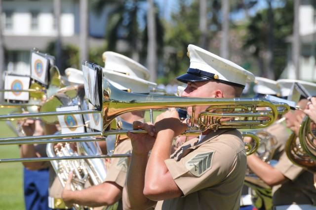 Members of the Marine Corps Forces Pacific Band play service medleys during the 34th annual JROTC ceremony at the historic Palm Circle on Fort Shafter, HI, Apr 21, 2016.