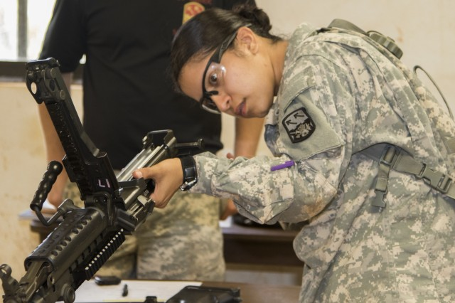 JOINT BASE PEARL HARBOR-HICKAM, Hawaii-U.S. Army Spc Zuleima Garcia, a native of Oakdale, Calif. and an air defense enhanced early warning system operator, with Headquarters and Headquarters Battery, 1st Battalion, 1st Air Defense Artillery Regiment, 94th Army Air and Missile Defense Command, dissembles a weapon, April 26, 2016, during the warrior task testing portion of the 94th AAMDC's Soldier of the Year 2016 competition at Schofield Barracks East Range, Hawaii. (U.S. Army photo by Staff Sgt. Michael Shrum, 94th Army Air and Missile Defense Command Public Affairs.)
