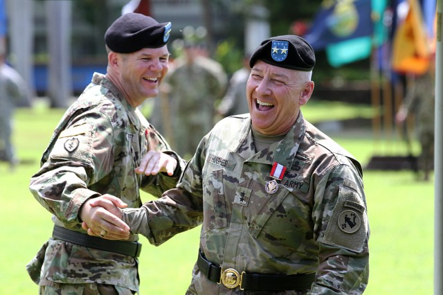 FORT SHAFTER, Hawaii- Maj. Gen. Todd B. McCaffrey, Deputy Commanding General-South, U.S. Army Pacific shakes hands with Maj. Gen. Christopher P. Hughes, Chief of Staff, USARPAC, during a Flying V ceremony, May 6, at historic Palm Circle, Fort Shafter, Hawaii. The name, Flying V, refers to the way the colors are posted during the ceremony, which is V-shaped. (U.S. Army photo by, Staff Sgt. Kyle J. Richardson, USARPAC PAO)