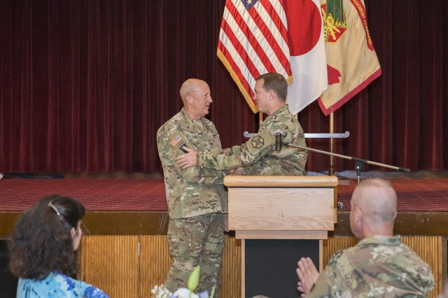 Col. Harry Rauch; left, region command chaplain for IMCOM-Pacific at Fort Shafter, H.I. receives appreciation from Col. William B. Johnson; right, commander of USAG Japan, during the conclusion of the National Prayer Breakfast May 5 at Camp Zama Community Club. (U.S. Army photo by Honey Nixon)