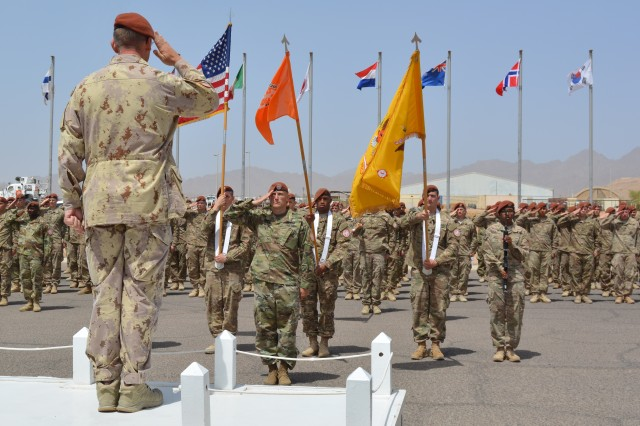 Leaders assigned to 1st Squadron, 2nd Cavalry Regiment salute Maj. Gen. Denis Thompson (left,) the Multinational Force Obervers (MFO) Commander, during his inspection of Troops while participating in the unit's MFO award ceremony held at Sharm El-Sheikh, Egypt, May 5, 2016. The medal is an international military decoration that is awarded to all Soldiers supporting the MFO, regardless of nationality, and is awarded after 170 days of service.