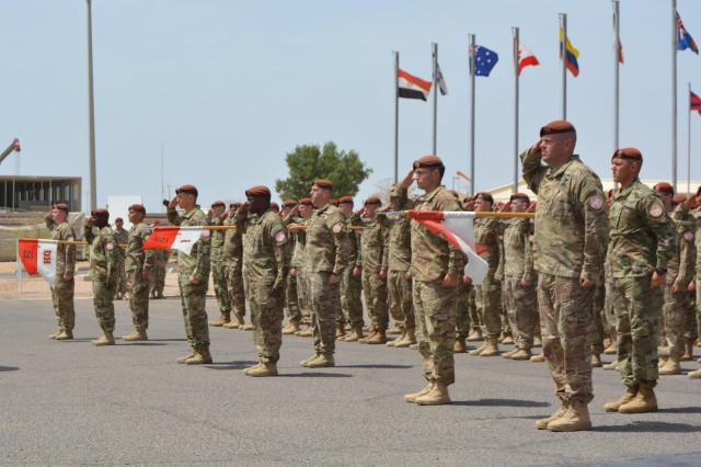 Leaders assigned to 1st Squadron, 2nd Cavalry Regiment salute Maj. Gen. Denis Thompson (left,) the Multinational Force Observers (MFO) Commander, during his inspection of Troops while participating in the unit's MFO award ceremony held at Sharm El-Sheikh, Egypt, May 5, 2016. The medal is an international military decoration that is awarded to all Soldiers supporting the MFO, regardless of nationality, and is awarded after 170 days of service.