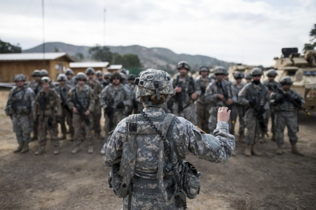1st Lt. Danielle Foley, a U.S. Army Reserve military police platoon leader from Phoenix, Arizona, briefs Third Platoon, 56th Military Police Company (Combat Support), of Mesa, Arizona, before conducting a cordon and search training lane at Fort Hunter-Liggett, Calif., May 4.