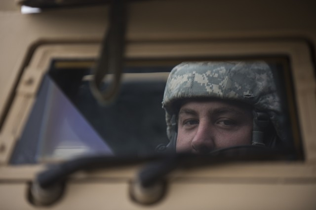 Spc. Kevin Helms, a U.S. Army Reserve military police Soldier of Phoenix, Arizona, with the 56th Military Police Company (Combat Support), of Mesa, Arizona, looks through a window of an M1117 Armored Security Vehicle before a cordon and search training lane at Fort Hunter-Liggett, Calif., May 4.