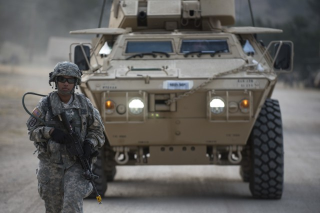 Spc. Adrianna Harris, a U.S. Army Reserve military police Soldier from Los Angeles, with the 56th Military Police Company (Combat Support), of Mesa, Arizona, ground-guides an M1117 Armored Security Vehicle in preparation for a cordon and search training lane at Fort Hunter-Liggett, Calif., May 4.