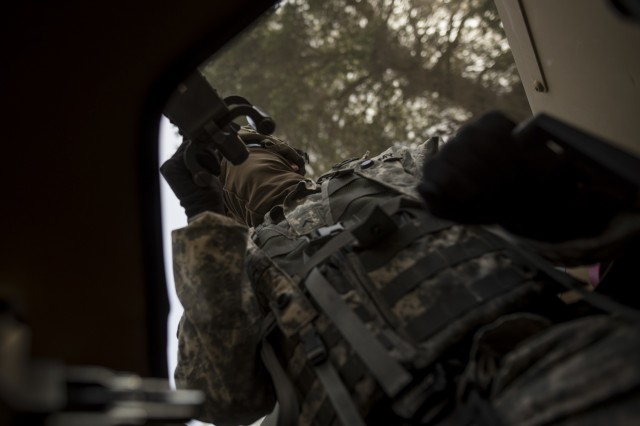 Pvt. Anthony Peterson, a U.S. Army Reserve military police Soldier from Apache Junction, Arizona, with the 56th Military Police Company (Combat Support), of Mesa, Arizona, rides in the gunner turret during a cordon and search training lane at Fort Hunter-Liggett, Calif., May 4.