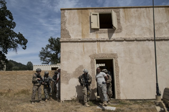 Two teams of U.S. Army Reserve military police Soldiers from the 56th Military Police Company (Combat Support), of Mesa, Arizona, find and detain two high-value targets during a cordon and search training lane at Fort Hunter-Liggett, Calif., May 4.