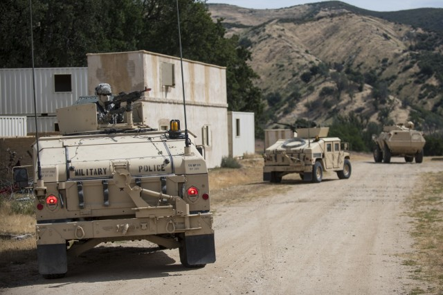 A convoy of gunner vehicles pull security in a makeshift village during a cordon and search training lane at Fort Hunter-Liggett, Calif., conducted by U.S. Army Reserve military police Soldiers from the 56th Military Police Company (Combat Support), of Mesa, Arizona, May 4.