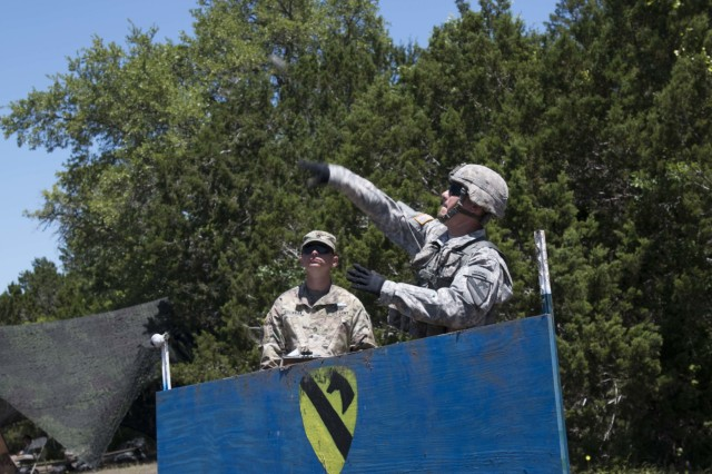 1st Lt. Gavin Moore, an infantry officer assigned to Company A, 1st Battalion, 8th Cavalry Regiment, 2nd Armored Brigade Combat Team, 1st Cavalry Division, attempts to throw a hand grenade to reach a 35 meter target during the training phase of the Expert Infantryman Badge training and testing at Fort Hood, Texas, May 3. More than 700 Soldiers from the 1st Cavalry Division, as well as some from Fort Carson and Fort Polk, underwent two weeks of training and one week of testing in basic infantry skills attempting to earn the EIB.
