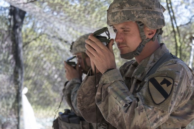 2nd Lt. Justin Adams, an infantry officer assigned to Company B, 1st Battalion, 5th Cavalry Regiment, 2nd Armored Brigade Combat Team, 1st Cavalry Division,  shoots an azimuth with a lensatic compass during the resection station of the Expert Infantryman Badge training and testing at Fort Hood, Texas, May 3. More than 700 Soldiers from the 1st Cavalry Division, as well as some from Fort Carson and Fort Polk, underwent two weeks of training and one week of testing in basic infantry skills attempting to earn the EIB at Fort Hood, Texas, from April 25 to May 13.
