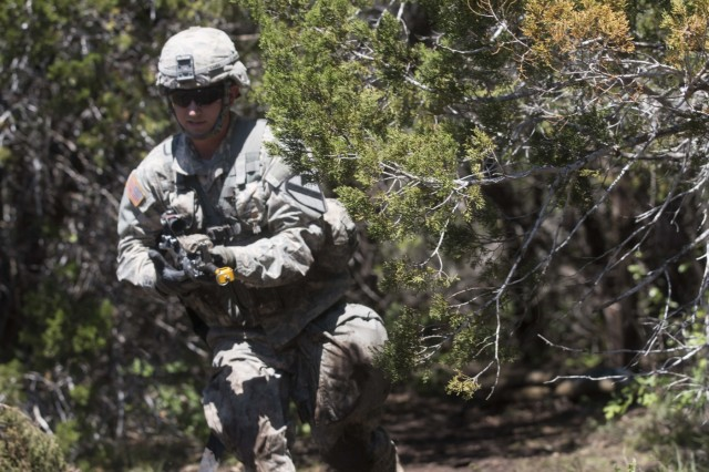 Spc. John Asher, an infantryman assigned to Company A, 1st Battalion, 5th Cavalry Regiment, 2nd Armored Brigade Combat Team, 1st Cavalry Division, performs the three-to-five-second rush at the moement under direct fire station of the Expert Infantryman Badge training and testing at Fort Hood, Texas, May 3. More than 700 Soldiers from the 1st Cavalry Division, as well as some from Fort Carson and Fort Polk underwent two weeks of training and one week of testing in basic infantry skills to earn the EIB at Fort Hood, Texas, from April 25 to May 13.