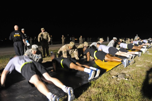 Candidates perform push-ups while participating in Expert Infantryman Badge testing May 9 on Fort Hood. The APFT was the first hurdle to clear of the weeklong testing.