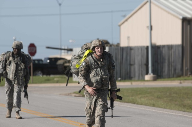 Sgt. Nicholas Santos, a senior medic assigned to the 2nd Battalion; 7th Cavalry Regiment, 3rd Armored Brigade Combat Team, 1st Cavalry Division, passes up Sgt Edwin Luchendo, a medic assigned to the 215th Brigade Support Battalion, 3rd ABCT, during the last leg of the 12-mile foot march at the division's Best Medic Competition.Twelve First Team Soldiers competed to earn the opportunity to represent the 1st Cavalry Division in this year's Best Medic Competition in San Antonio in October.