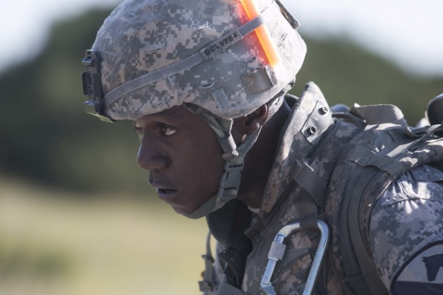 Sgt. Edwin Luchendo, a medic assigned to the 215th Brigade Support Battalion, 3rd Armored Brigade Combat Team, 1st Cavalry Division, looks toward the finish line as he walks the last leg of the 12-mile foot march during the division's Best Medic Competition. Twelve First Team Soldiers competed to earn the opportunity to represent the 1st Cavalry Division in this year's Best Medic Competition in San Antonio in October.