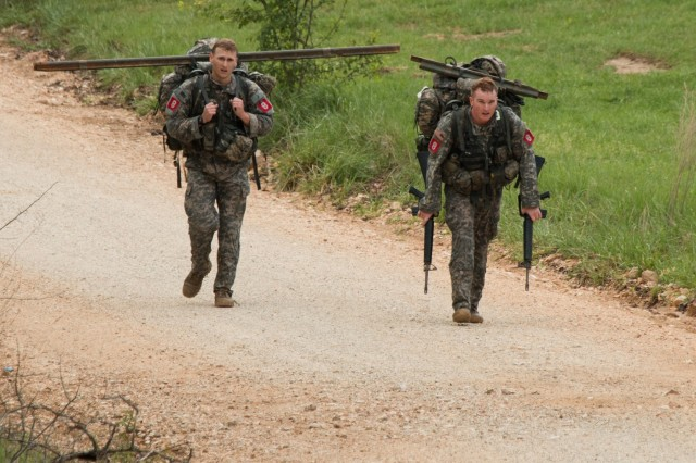 After a 25-minute swim during a poncho raft event, Captains William Whitfield (left) and Michael McLaughlin travel three miles to the next event during the Best Sapper Competition held April 19-21 at Fort Leonard Wood, Missouri. Often described as the Army Engineer Corps Olympic-level test, the competition measures resiliency, physical and mental stamina, and technical and tactical proficiency. (U.S. Army photo by Command Sgt. Maj. Daniel D. Kelch, 3rd Armored Brigade Combat Team Public Affairs Office, 1st Cavalry Division