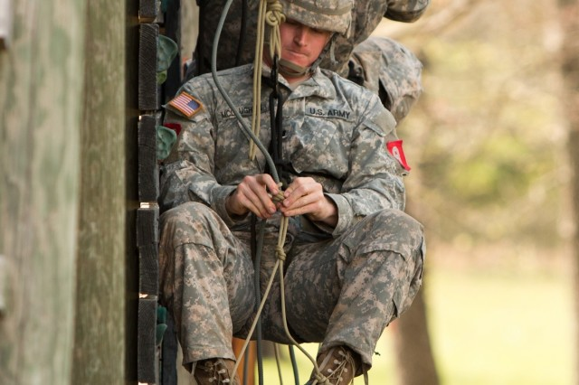 Capt. Michael McLaughlin, a native of Evans Mills, New York, studies his knot while conducting a prusik ascent up a 45-foot tower during the Best Sapper Competition held April 19-21 at Fort Leonard Wood, Missouri. The competition measures the resiliency, physical and mental stamina, and technical and tactical proficiency of top engineers who dare to take on the challenge. (U.S. Army photo by Command Sgt. Maj. Daniel D. Kelch, 3rd Armored Brigade Combat Team Public Affairs Office, 1st Cavalry Division