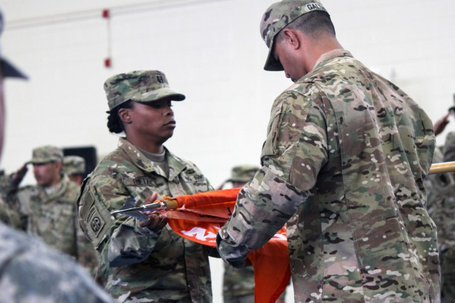 FORT GORDON, Ga.- Capt. Natasha Fultz, company commander, and 1st Sgt. Faamasino Galoia, company first sergeant, the command team of the 518th Tactical Installation and Networking Company, 67th Signal Battalion (Expeditionary), 35th Signal Brigade (Theater Tactical), prepare the colors for casing during a ceremony at the Cyber Fitness Center, Fort Gordon, Ga., May 6, 2016 leading up to a 9-month deployment in support of U.S. Central Command in Southwest Asia.(U.S. Army photo by Staff Sgt. Ashley M. Cohen, 35th Signal Brigade (Theater Tactical) Public Affairs)