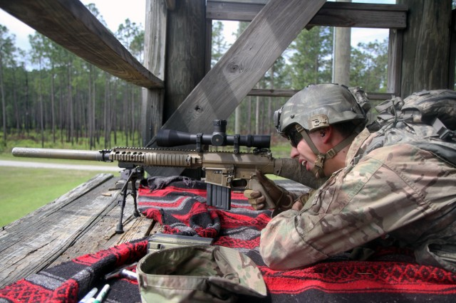 Spc. Blake Reyna, an infantryman with Troop C, 6th Squadron, 8th Cavalry Regiment, 2nd Infantry Brigade Combat Team, 3rd Infantry Division, demonstrates how to shoot an M110 semi-automatic sniper system at Fort Stewart Ga., May 3, 2016. The M110 is a precision weapon known for its accuracy and is usually used on patrols. (U.S. Army photo by Spc. John Onuoha / Released)