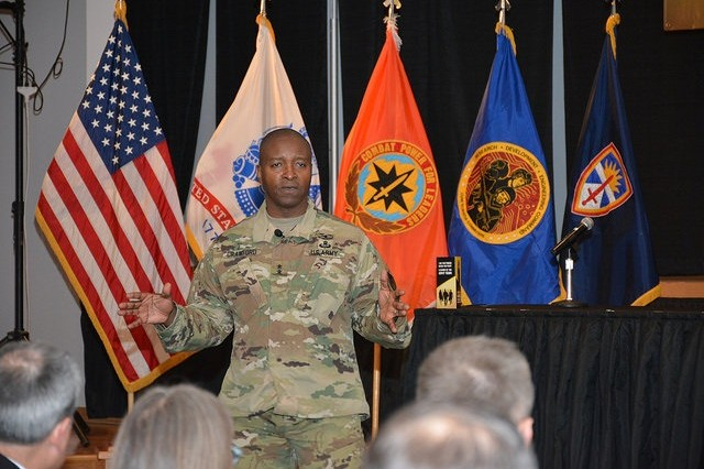 Communications-Electronics Command Commanding General and APG Senior Installation Commander,  Maj. Gen. Bruce Crawford, addresses the audience during the early stages of the 2016 APG SHARP Summit, May 10, 2016, in the Mallette Auditorium.