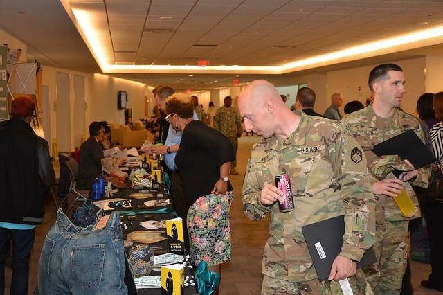 Information tables were busy centers of attention during breaks from the 2016 APG SHARP Summit held at the Mallette Auditorium on Aberdeen Proving Ground, Md., May 10.
