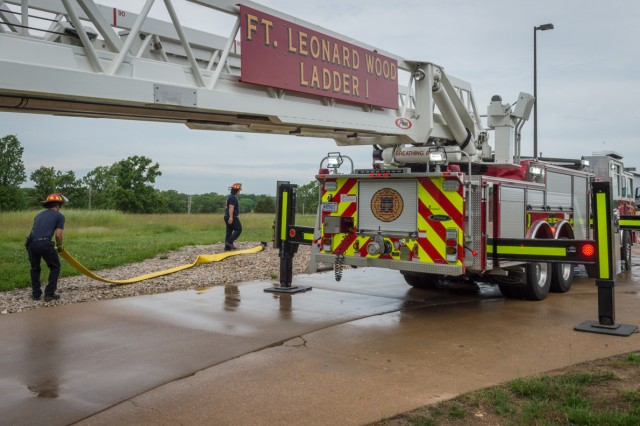 Firefighters Greg Record, left, and James Bloodworth conduct vehicle and equipment checks on Fort Leonard Wood Ladder 1. These checks are performed on a daily basis.