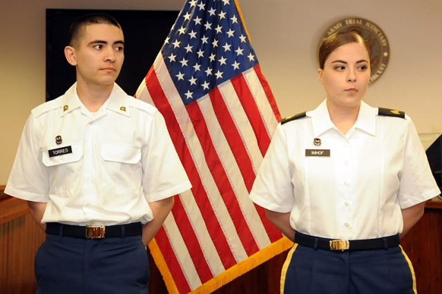 Sgt. Abigail Imhof, trial defense services noncommissioned officer in charge, and Spc. Javier Torres, paralegal specialist, are recognized by the Fort Leonard Wood Staff Judge Advocate office for being named the Paralegal NCO and Soldier of the year.