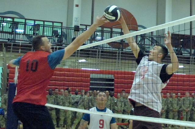From left, Stephen Piechura, MSCoE, tries to block a spike attempt by Tucker Jones, 554th Engr. Bn., in the second game of the championship match of the 2016 Commander's Cup Volleyball Tournament May 4.