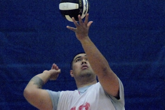 Silibelio Iosefo, 554th Engr. Bn., prepares to serve in the championship match of the 2016 Commander's Cup Volleyball Tournament May 4 at Davidson Fitness Center.