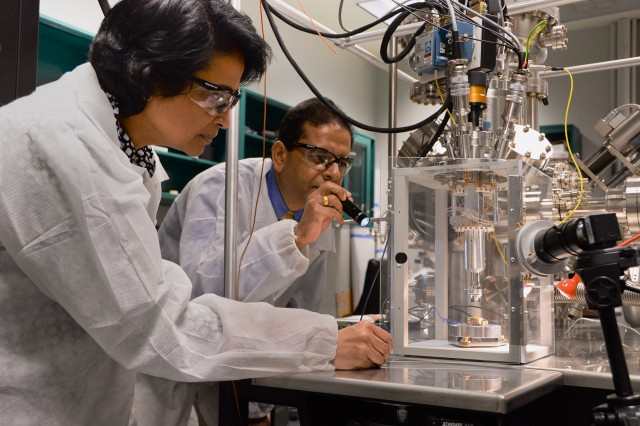 Dr. Govind Mallick (right), a research chemist with the U.S. Army Research Laboratory, and Dr. Lily Giri, a physicist who works as a contractor at ARL, are investigating the structure and morphology of the sample at atomic level and ambient conditions through scanning tunneling microscopy at Aberdeen Proving Ground, Maryland, Sept. 15, 2014.