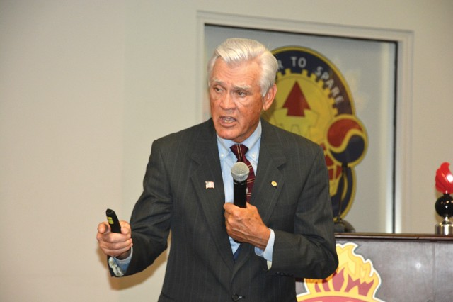 Retired Air Force Lt. Col. Barry Bridger discusses the trials of American prisoners of war during Vietnam and their American spirit that helped them through the bruality during a leader professional development session May 10 with the 59th Ordnance Brigade.