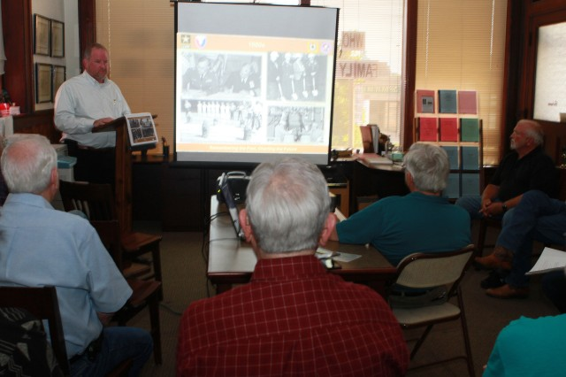 Brian Lott, chief of staff at McAlester Army Ammunition Plant, Okla., tells members of the Pittsburg County Genealogical and Historical Society about the transfer of the then U.S. Naval Ammunition Depot, McAlester, to the Army under the Single Manager for Conventional Munitions on Oct. 1, 1977.