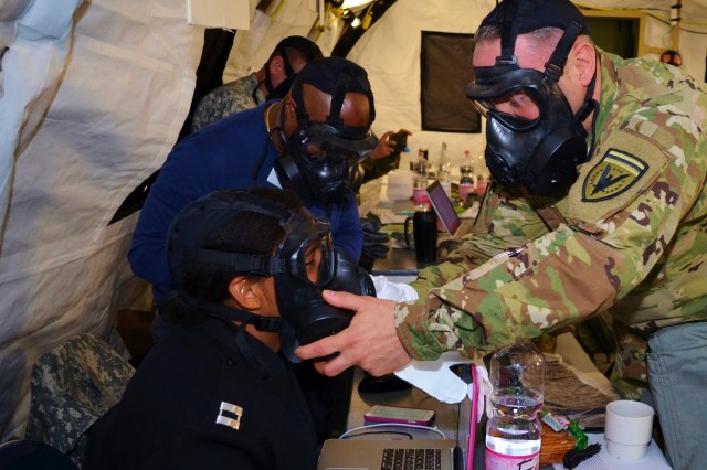 A U.S. Army officer and civilian check the seal on the protective mask of a U.S. Navy officer Monday, May 2, 2015 during Exercise Anakonda Response 2016, Friday, April 29, 2016 at Papa Air Base in Hungary. For the roughly two-week long event, the U.S. organized a full assembly of military representation: Army, Navy, Marine Corps, Army Reserve, Army National Guard and Air National Guard. Also, the Hungarian military hosted the United Kingdom's Royal Army and Corps of Royal Marines.