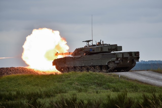 An Italian Ariete tank fires at its target, during the Strong Europe Tank Challenge, at the 7th Army Joint Multinational Training Command's Grafenwoehr Training Area, Grafenwoehr, Germany, May 12, 2016. (U.S. Army photo by Spc. Nathanael Mercado/Released)