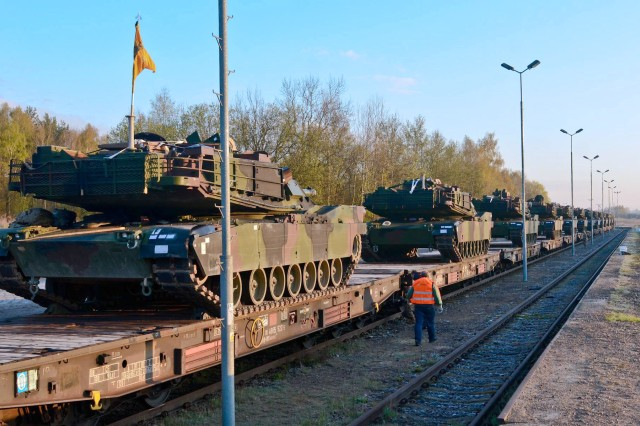 Soldiers from 3rd Battalion, 69th Armor Regiment, prepare to download U.S. Army M1A2 Abrams Main Battle Tanks from a train at Drowsko Pomorskie, Poland. Soldiers from the battalion brought the tanks and Bradley Fighting Vehicles back to Poland as they took over the Operation Atlantic Resolve mission in the country, May 1.