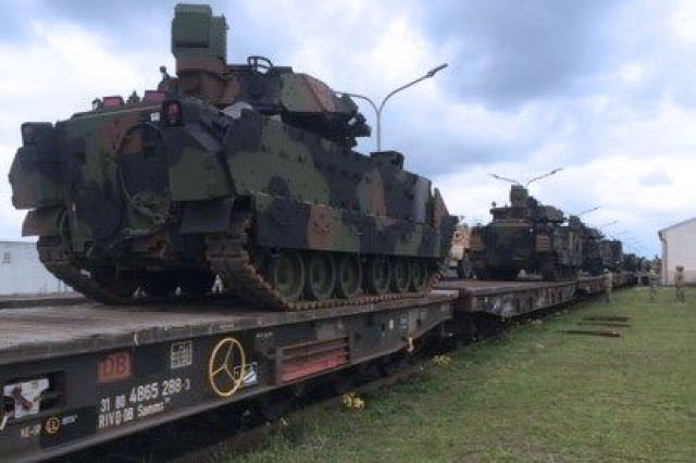 U.S. Army M2A3 Bradley Infantry Fighting Vehicles are loaded onto a train at Coleman Worksite, Germany on their way to Drowsko Pomorskie, Poland. Soldiers from 3rd Battalion, 69th Armor Regiment brought the Bradleys and M1A2 Abrams Main Battle Tanks back to Poland as they took over the Operation Atlantic Resolve mission in the country, May 1.