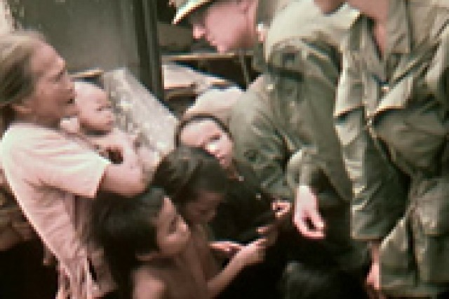 Capt. (Dr.) Ray Cave in Vietnam with civilian patients.