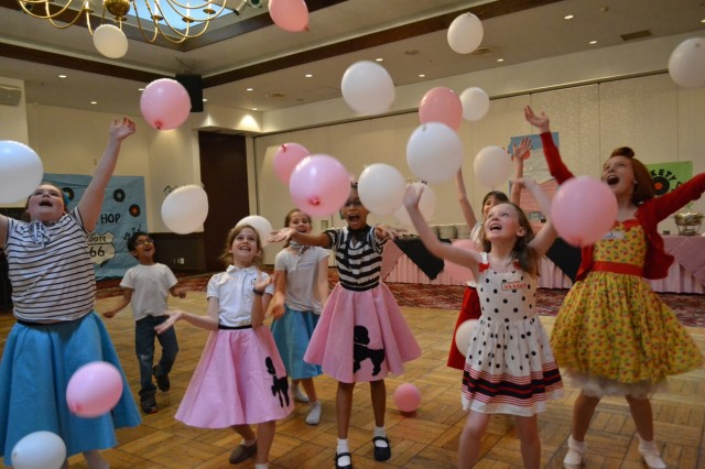 "Members from the CZ Girl Scouts play with balloons during the annual end-of-the year celebration, themed ""1950's Sock Hop,"" held May 7 at the Camp Zama Community Activity Center. (U.S. Army photo by Melanie Kincaid)"