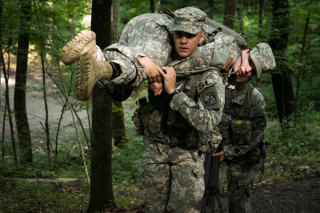 "Cadet Daniel Schultz, from University of Wisconsin - Steven's Point, carries an ""injured"" Cadet during CST 2015. (Photo by Cara Nordin, Cadet Command Public Affairs)"