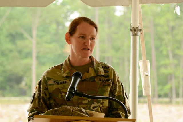 "Col. Stephanie Q. Howard, commander 2nd Transportation Brigade 94th Training Division, addresses the audience during the 94th TD's groundbreaking ceremony for a new training facility May 12, 2016. The 39,127-square-foot training center will be equipped with 15 classrooms and will include a maintenance training area for transportation courses, as well as a state of the art instructional kitchen for food service specialist courses. Ninety-fourth TD instructors could potentially train 2,635 Soldiers while teaching 120 classes annually. ""I'm excited that we will be one of the future tenants in this building we're here to celebrate,"" Howard said."