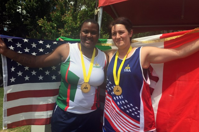 Medically retired Army Sgt. Monica Southall celebrates with 1st Maj. Cpl. Pellegrina Caputo of the Italian army after they both received gold medals in shot put in their respective disability categories during the track and field competition at the 2016 Invictus Games at the ESPN World Wide of Sports Complex at Walt Disney World, Orlando, Fla., May 10, 2016. Caputo asked Southall to trade jerseys to share in the camaraderie of the games, and she happily accepted. (DoD photo by Shannon Collins)
