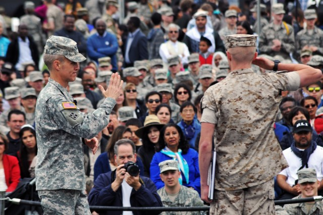 A U.S. Marine Corps student at the Defense Language Institute Foreign Language Center salutes after being recognized by the commandant, U.S. Army Col. Phillip J. Deppert, during Language Day 2016 at the Presidio of Monterey, California, May 13. Language Day is an annual open-house event that promotes and encourages cultural understanding and customs from around the world.