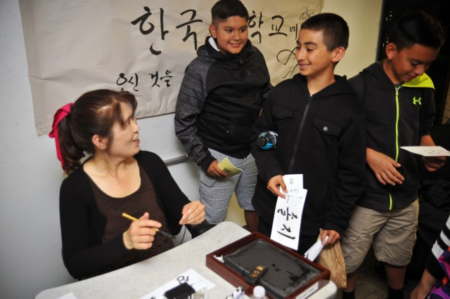 A Korean instructor interacts with visiting students during Language Day 2016 at the Presidio of Monterey, California, May 13. Language Day is an annual open-house event that promotes and encourages cultural understanding and customs from around the world.