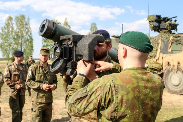 A Lithuanian Land Force Soldier teaches a Soldier with the German Army how to properly use a Javelin Anti-tank missile during Exercise Hunter, May 9, 2016, at General Silvestras Zukauskas Training Area in Pabrade, Lithuania. During the exercise, Soldiers from participating allied countries came together to learn the capabilities of each other's anti-tank weapons systems.